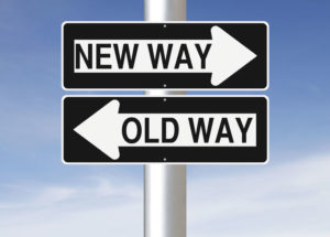 signs with different directions old way left arrow, new way right arrow